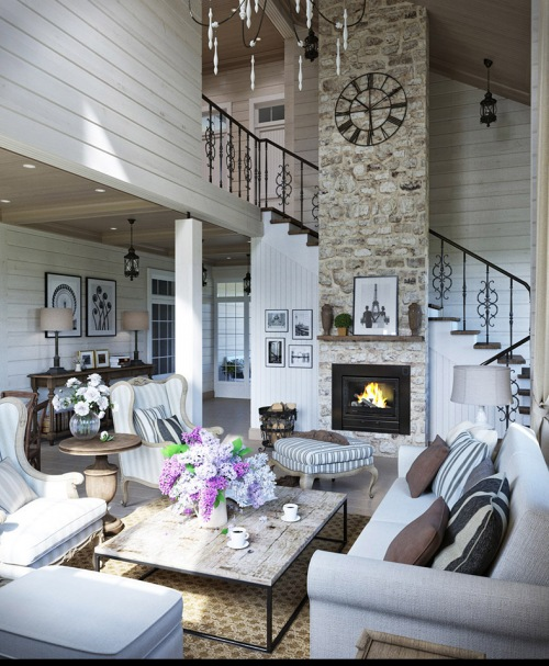 Bardzo wysoki salon z murowanym kominkiem, czyli oryginalna i elegancka aranżacja domu z prowansalskimi akcentami